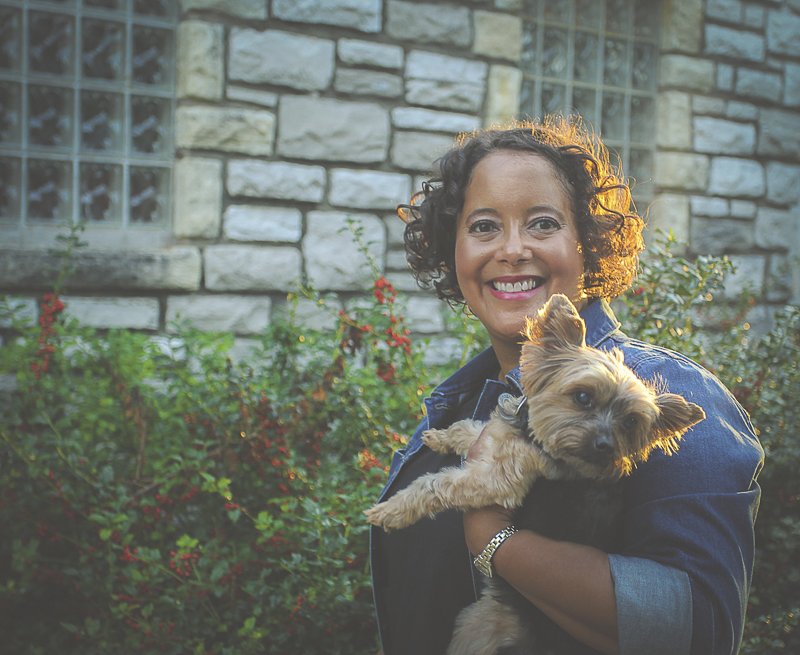 woman holding her Yorkie, golden hour photography | ©Aim With Mia Photography
