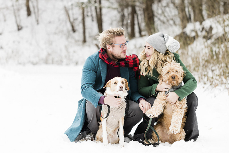 outside family portraits with dogs in the snow, winter photography ideas, cute doodle dog wearing blue sweater, ©Lauren Engfer Photography