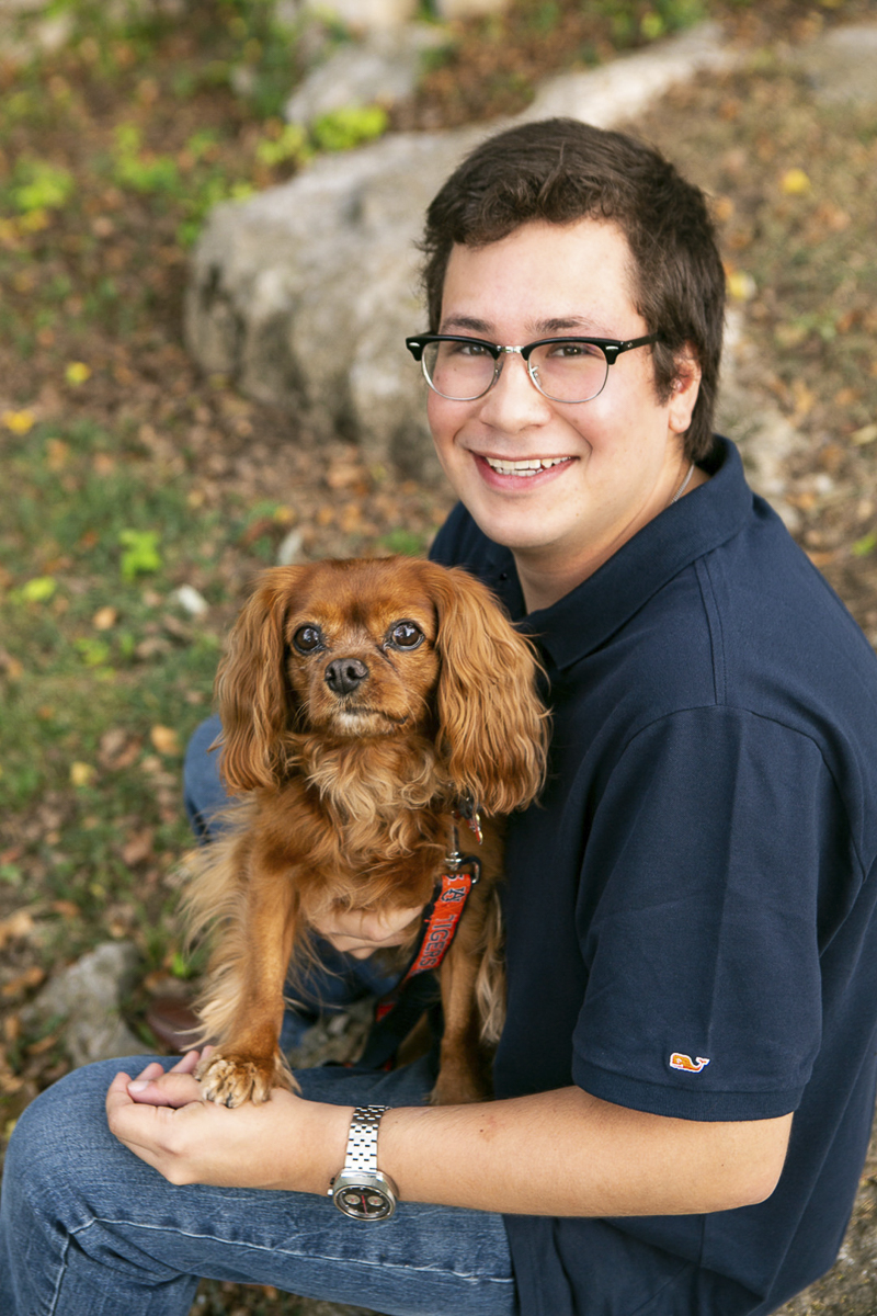 teen boy holding King Charles Cavalier rescue, ©Mandy Whitley Photography | dog photoshoot