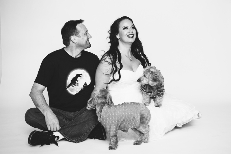 couple and their dogs wearing casual outfits, ©Nicole Caldwell Photography | dog-friendly studio engagement photos