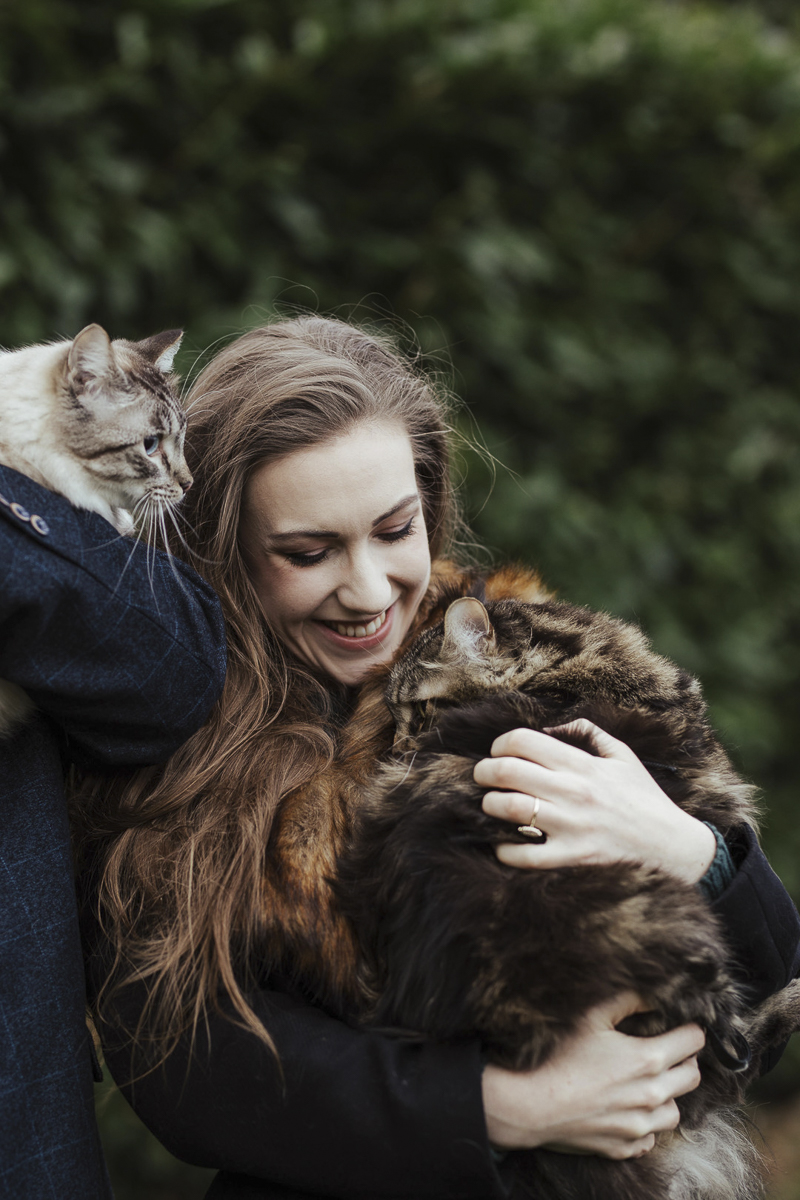 Maine Coon snuggling with woman outside, Ragdoll looking out, ©Olga Hogan Photography | engagement photos with cats