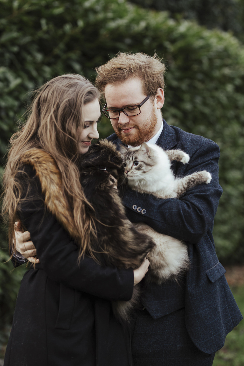 engaged couple holding their cats, ©Olga Hogan Photography | engagement photos with cats