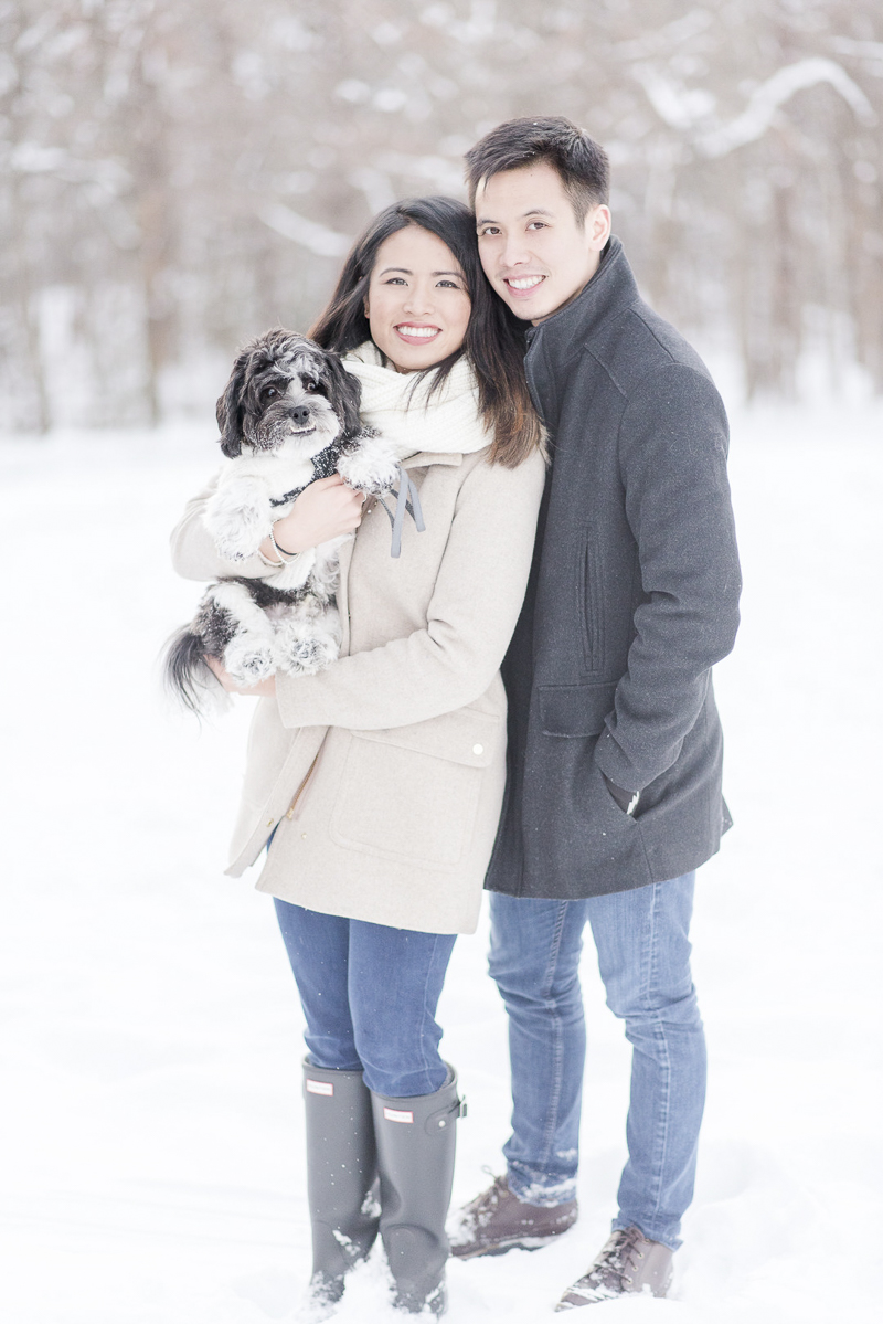 ©Rebecca Sigety Photography | snowy engagement photos with a dog, Reston, VA, woman holding small dog