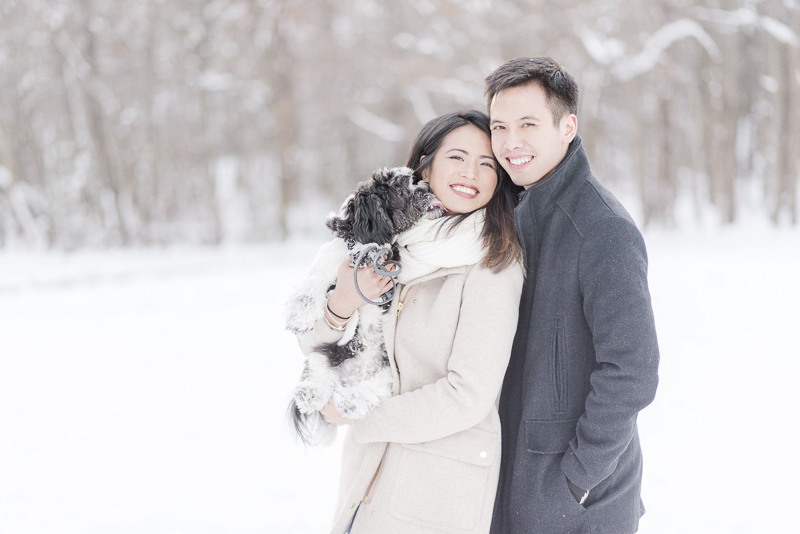 cute small dog licking woman's face, snowy engagement photos | ©Rebecca Sigety Photography
