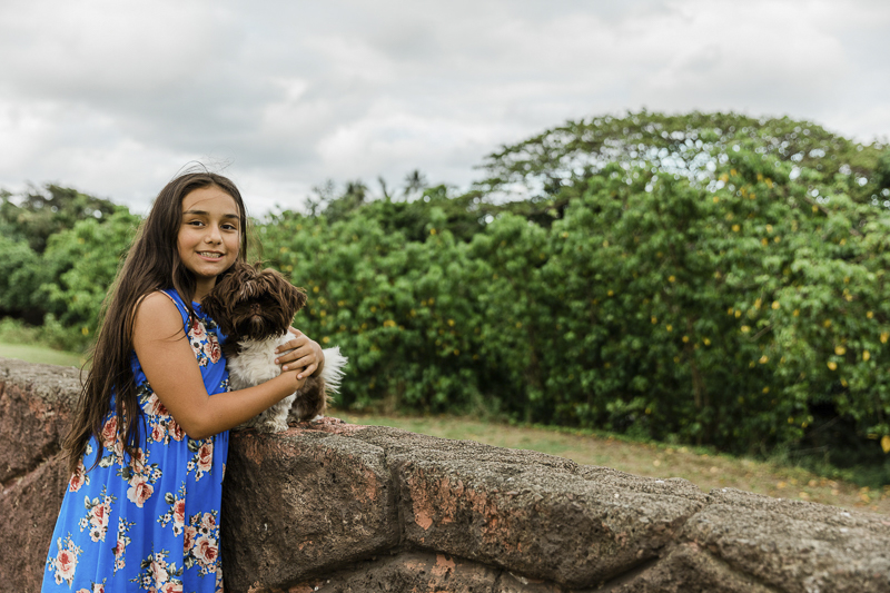 dog perched on wall, girl hugging her dog, ©Storm Elaine Photography, O'ahu, Hawaii