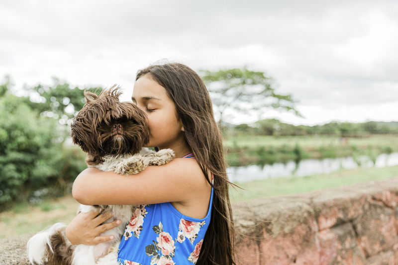 girl kissing her small dog, ©Storm Elaine Photography, O'ahu, Hawaii
