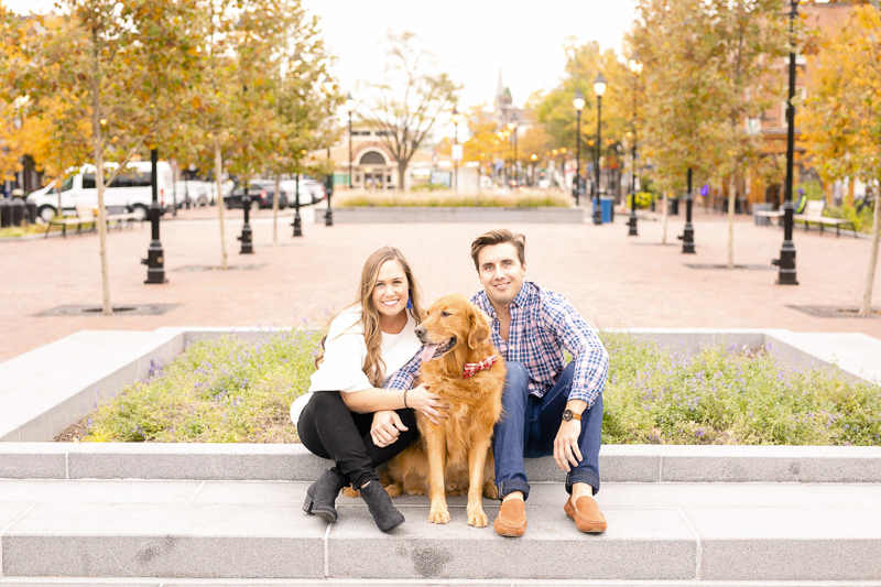 couple and their dog sitting on planter, engagment pictures with a dog, ©Amanda McPhee Studios |