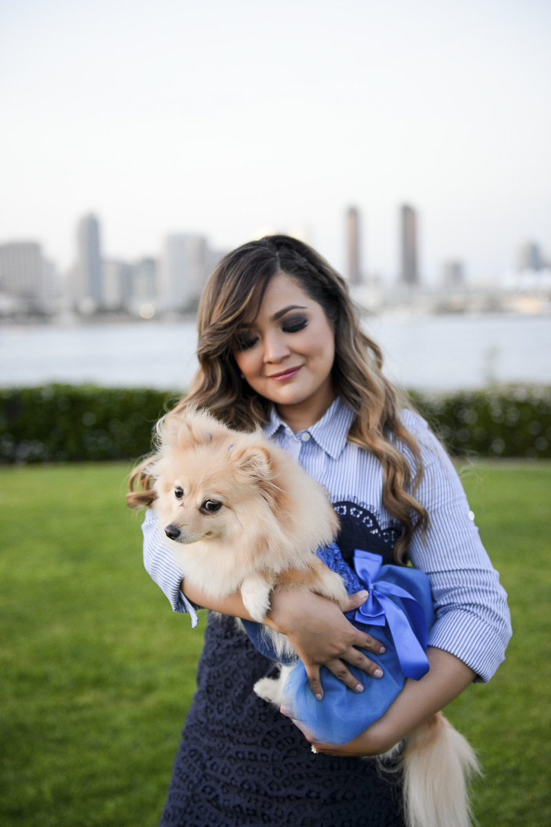 Pomeranian wearing blue dress, woman holding fur baby, ©CR Photography   dog-friendly family photos, Coronado