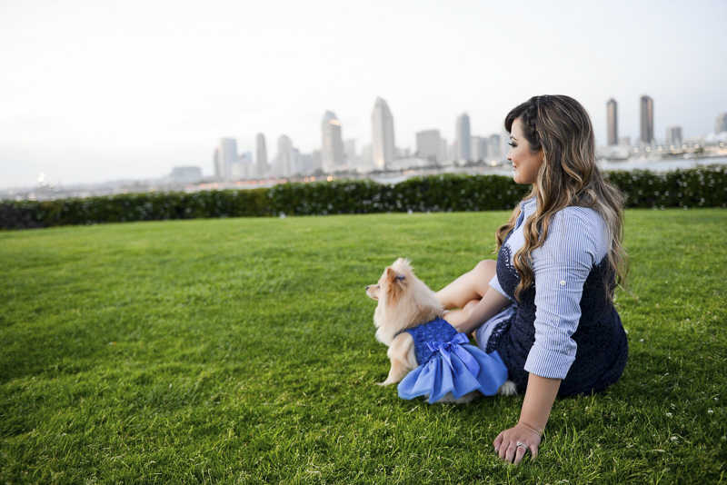woman and Pomeranian taking in the view, ©CR Photography | dog-friendly graduation photos