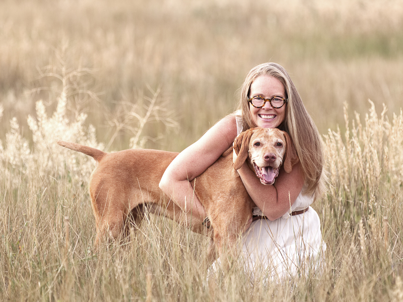 dog inspires woman to change her life, love between dog and human, woman hugging Vizsla, ©Good Morrow Photography