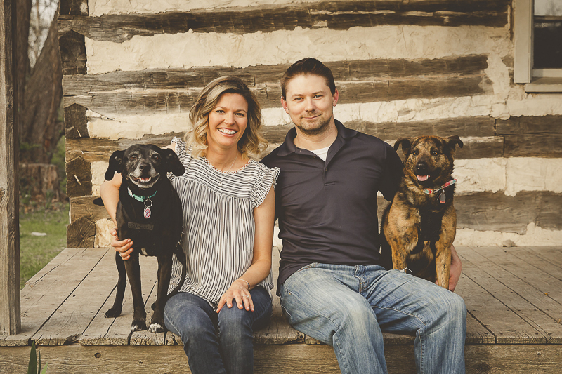 couple and their rescue dogs sitting on log cabin porch, ©Irish Eyes Photography | Lifestyle family and dog photographer, St Louis