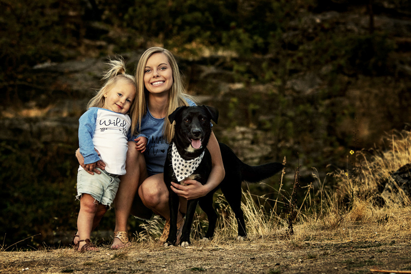 Spokane lifestyle family portraits with dogs, black mixed breed puppy wearing bandana, young mom and toddler girl, ©Noses and Toes Photography