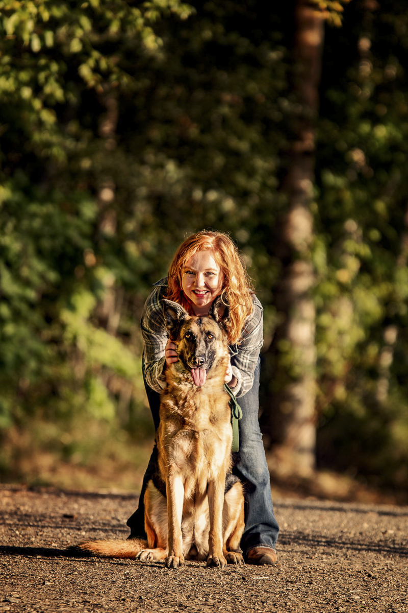 redhead woman and her German Shepherd in forest, ©Noses and Toes Photography, Spokane lifestyle dog photography