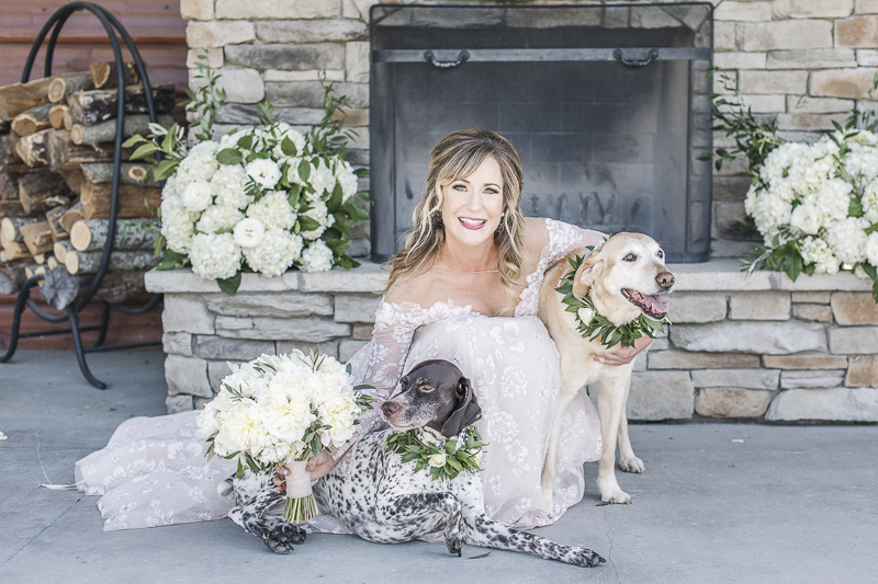 bride wearing blush dress with her dogs, GSP and Yellow Lab | epagaFOTO