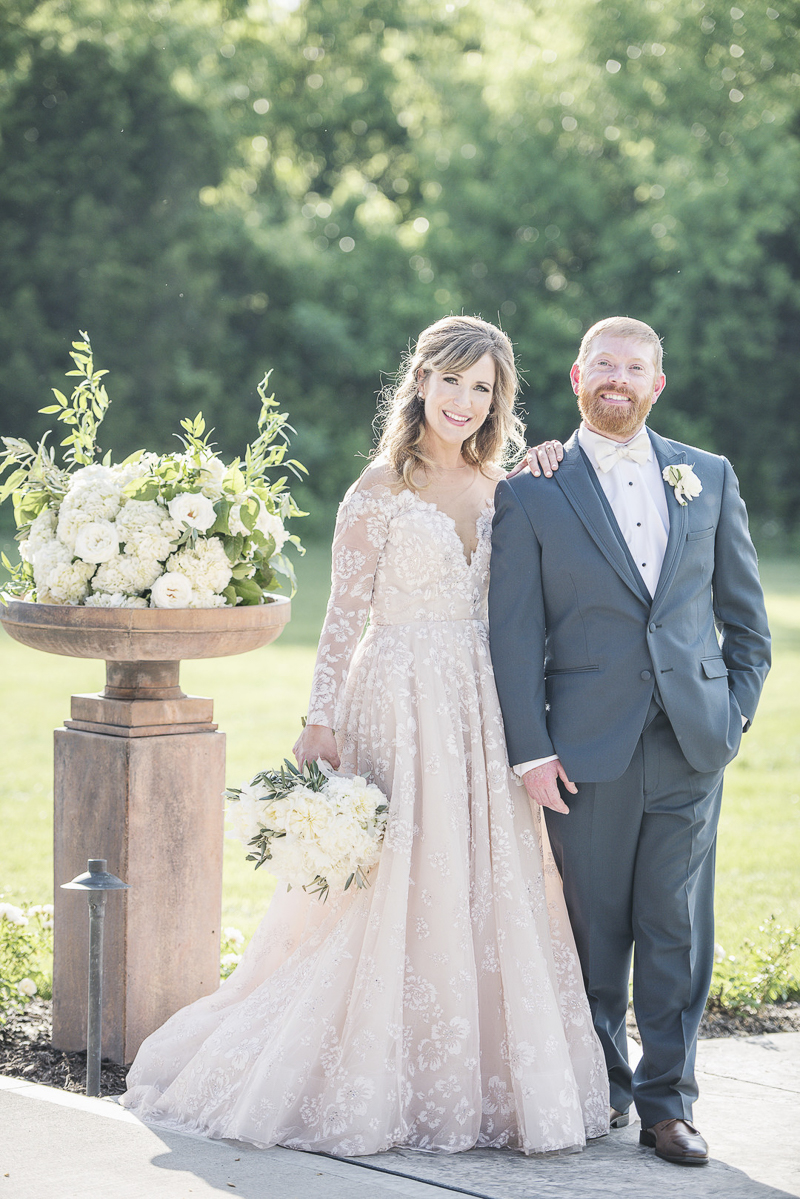 bride wearing blush dress, groom in steel blue tux | © epagaFOTO, Kansas City wedding photographer