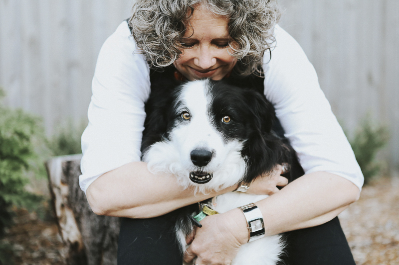 woman hugging her Border Collie, ©Dogfolk