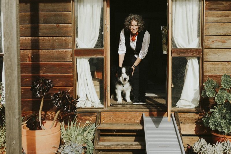 Melbourne in home pet photography, Border Collie and woman at doorway, steps and dog ramp | ©Dogfolk