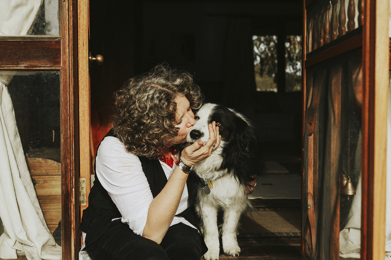 woman kissing her dog, heartwarming photos of cancer survivor and her dog, ©Dogfolk | Melbourne Pet Photographer | Storyteller - in home dog photography