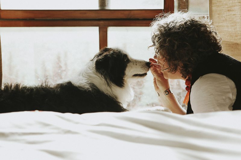 woman and Border Collie face to face, in home pet photography, love between dogs and humans | ©Dogfolk