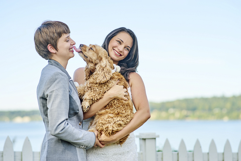 two brides and their dog, brides holding dog, English Cocker Spaniel