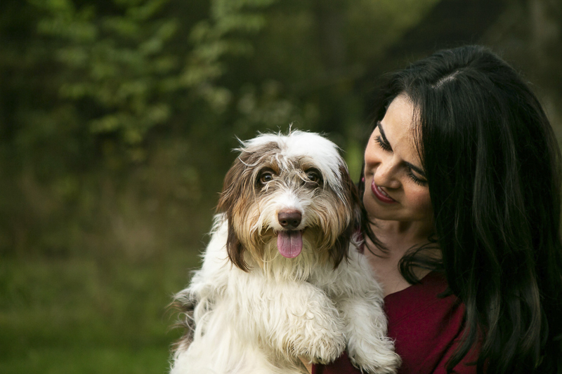 woman holding cute long haired Dachshund, © Mandy Whitley Photography | Nashville lifestyle dog photographer
