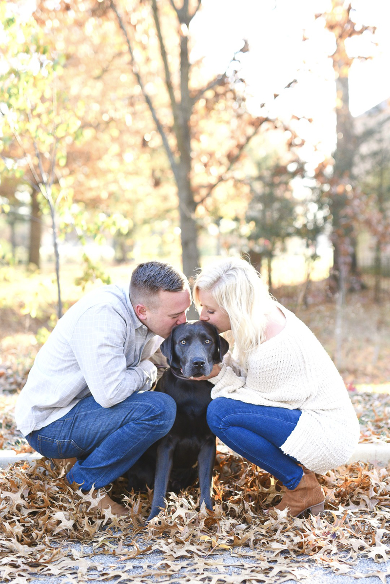 ©Jasmine Norris Photography couple kissing their dog's head, fall engagement portraits