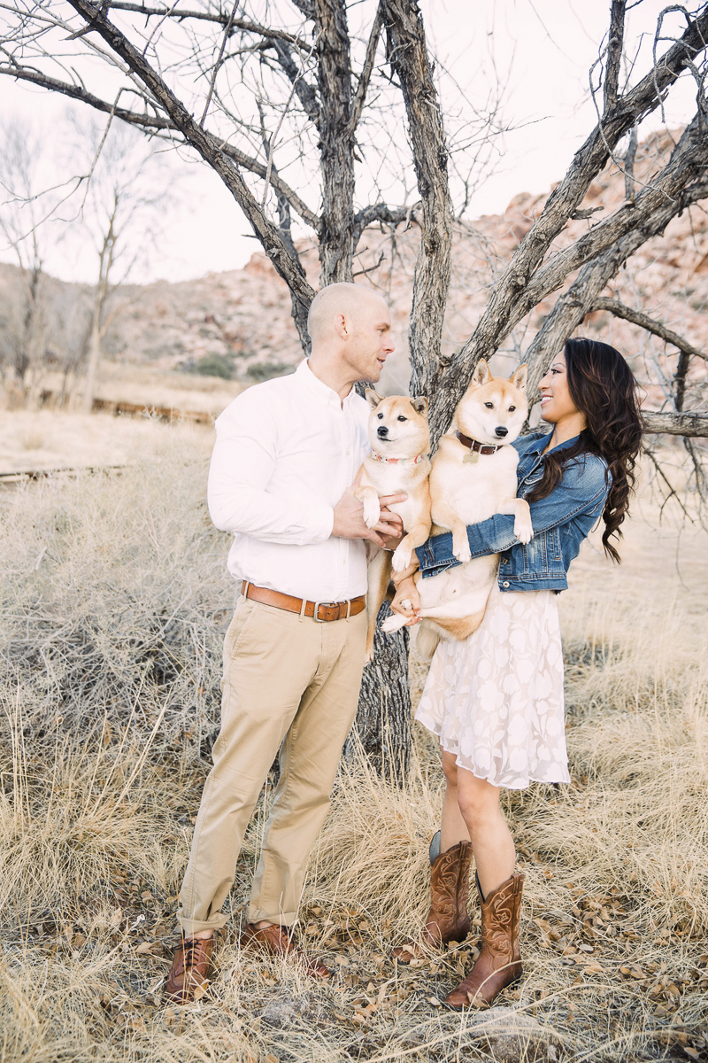 couple holding their Shiba Inus, engagement photos with dogs | ©Alycia Moore Photography