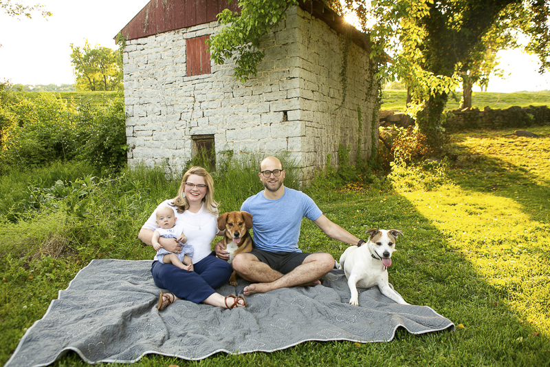 couple, baby, 2 dogs sitting on blanket | ©Mandy Whitley Photography, dog-friendly family photos Nashville