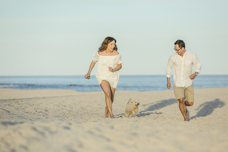 dog running on sand with his favorite people, dog-friendly destination, ©Daniel Jireh Photographer | Cabo San Lucas, Mexico
