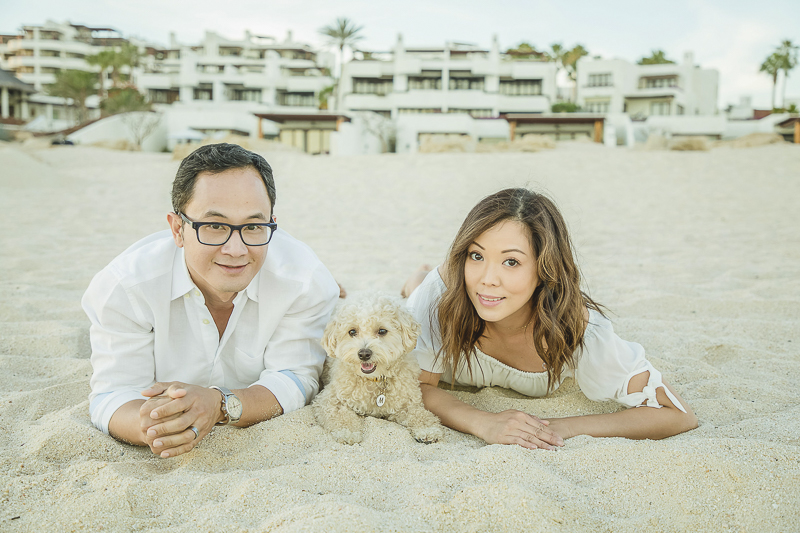 couple and their dog on the sand | ©Daniel Jireh Photographer | lifestyle family photography Cabo San Lucas, Mexico
