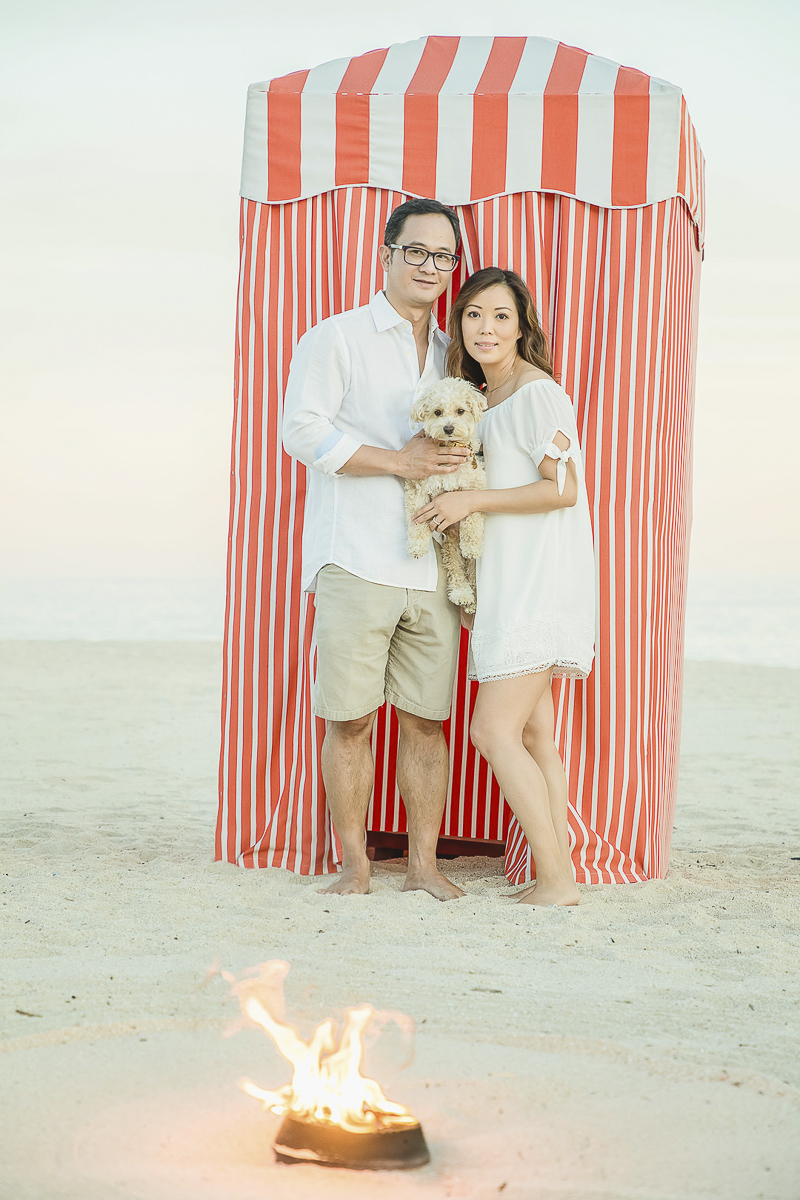 couple and their dog in front of striped cabana, Cabo San Lucas, ©Daniel Jireh Photographer