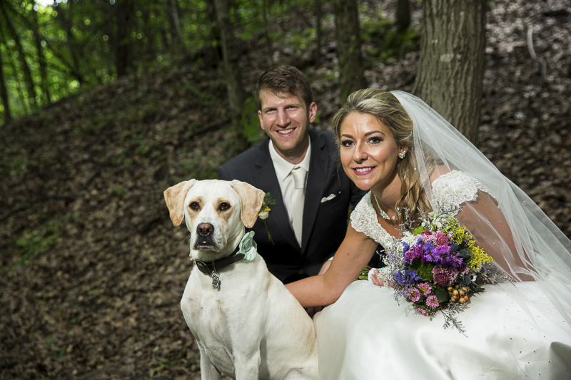 mixed breed dog wearing mint flower, bride and groom in the woods, ©Penny Photographics | Minnesota wedding photography