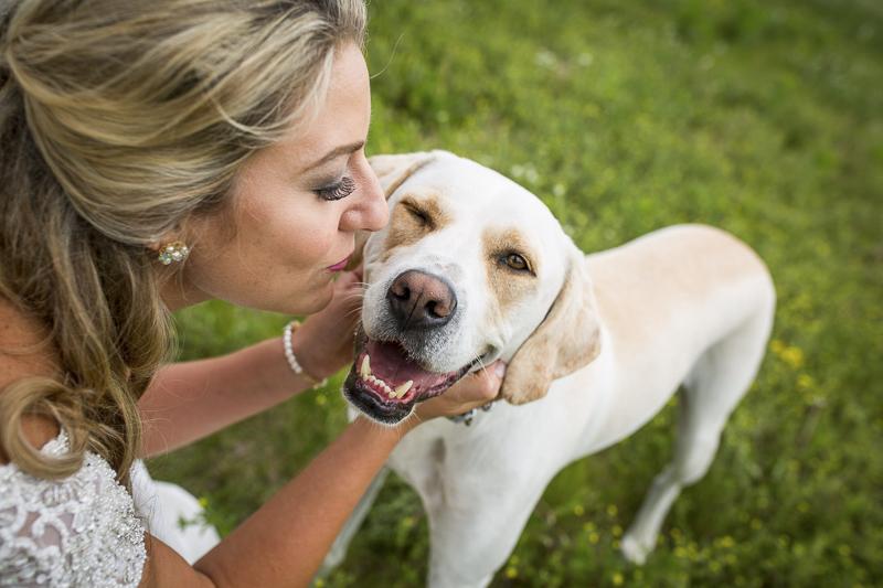 bride kissing her dog, dog winking   wedding dog, ©Penny Photographics  