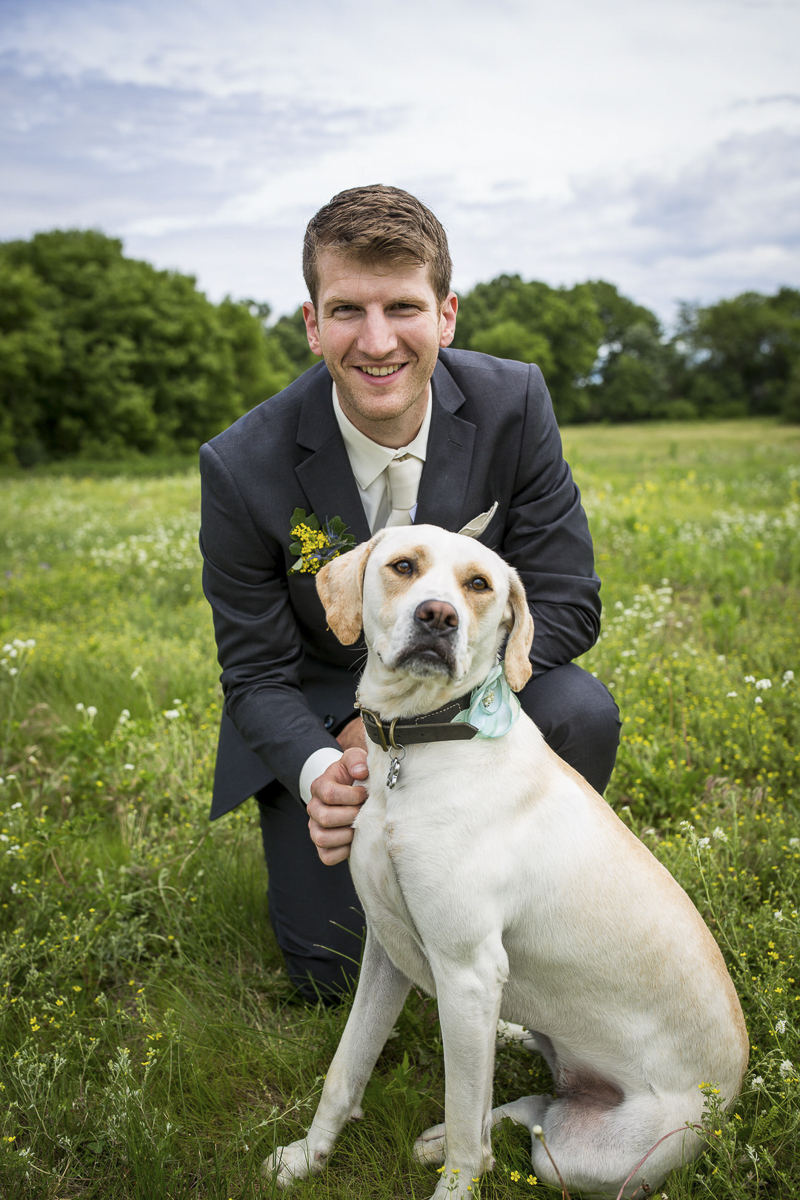 groom and his dog in grassy field, Eden Prairie, MN   ©Penny Photographics
