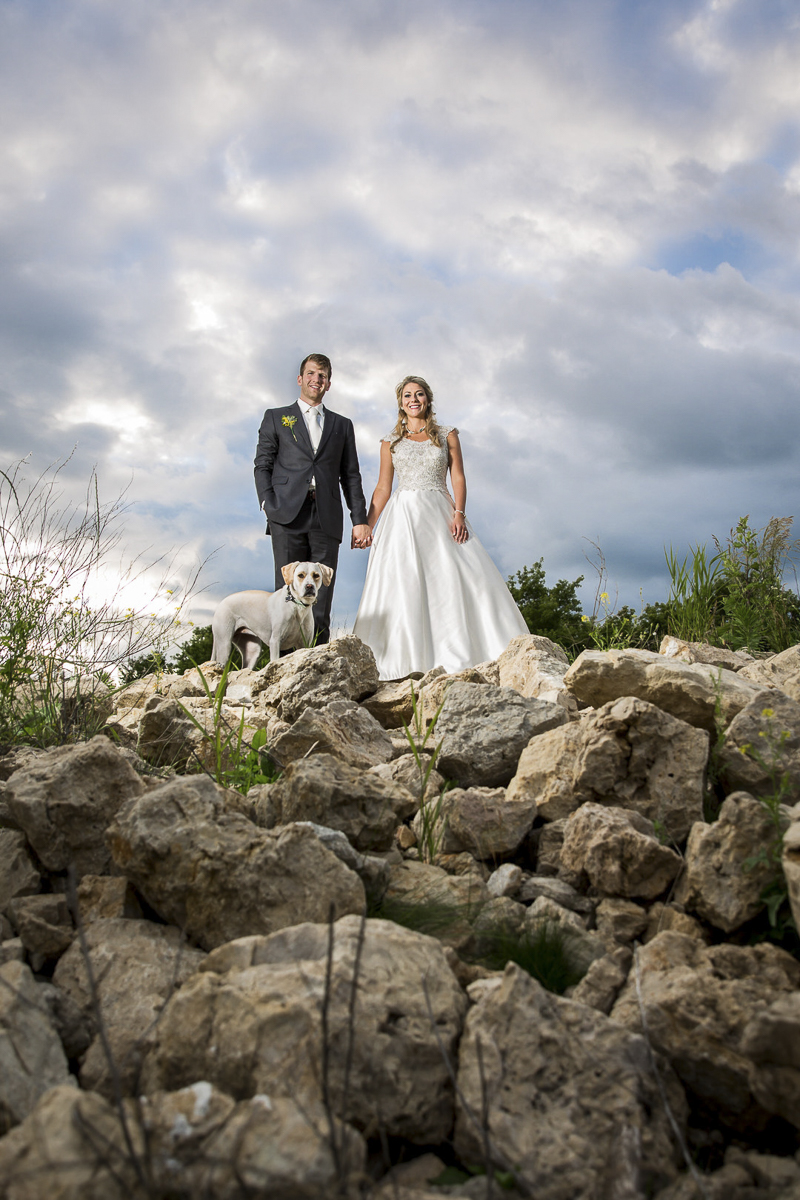wedding couple and their dog on top of rocks , ©Penny Photographic | Minnesota wedding photographer for adventurous couples, dog-friendly wedding
