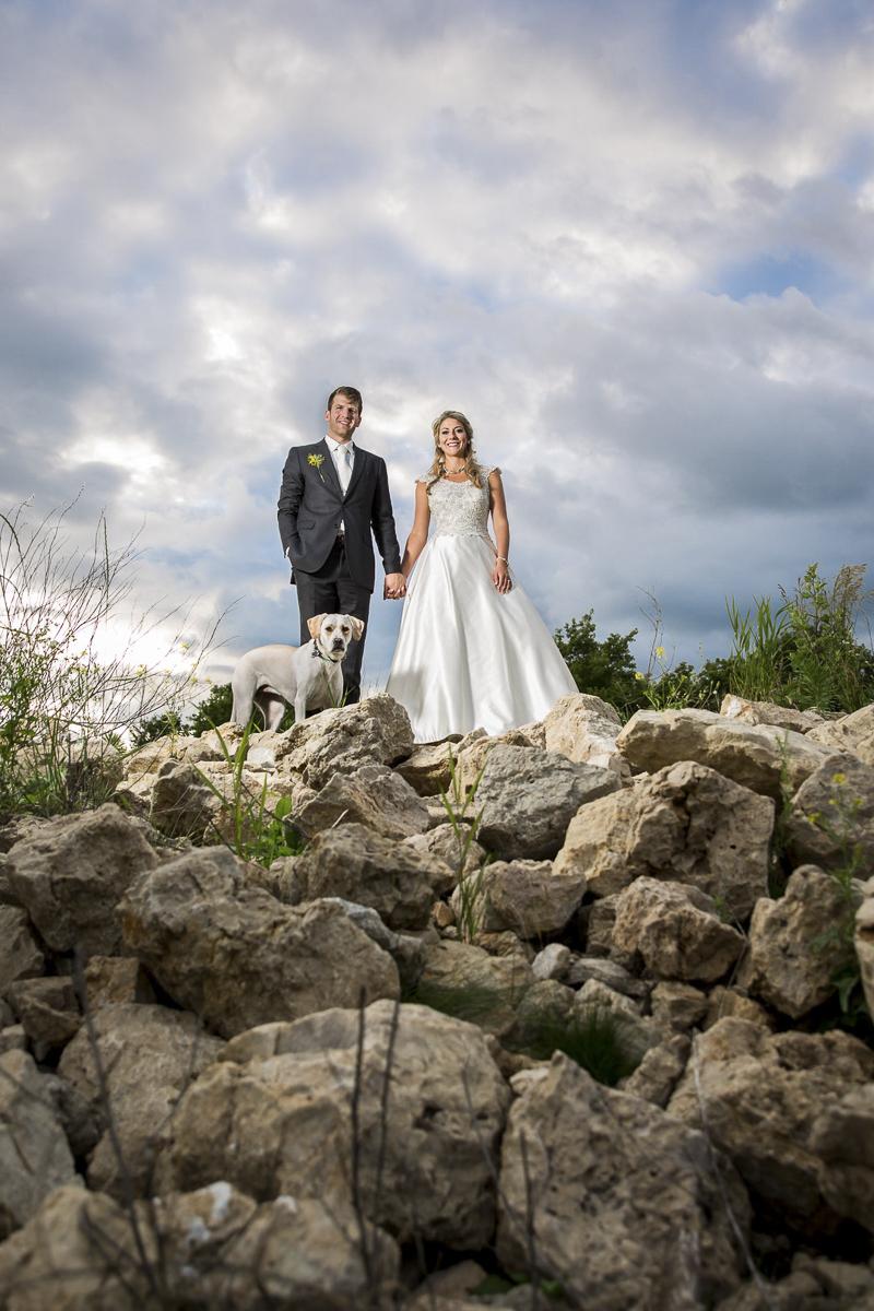 wedding couple and their dog on top of rocks , ©Penny Photographic   Minnesota wedding photographer for adventurous couples, dog-friendly wedding