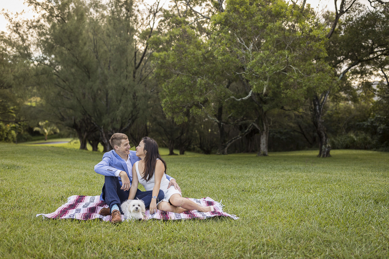 couple sitting on blanket with their Maltese, dog-friendly engagement photos, ©VIVIDfoto