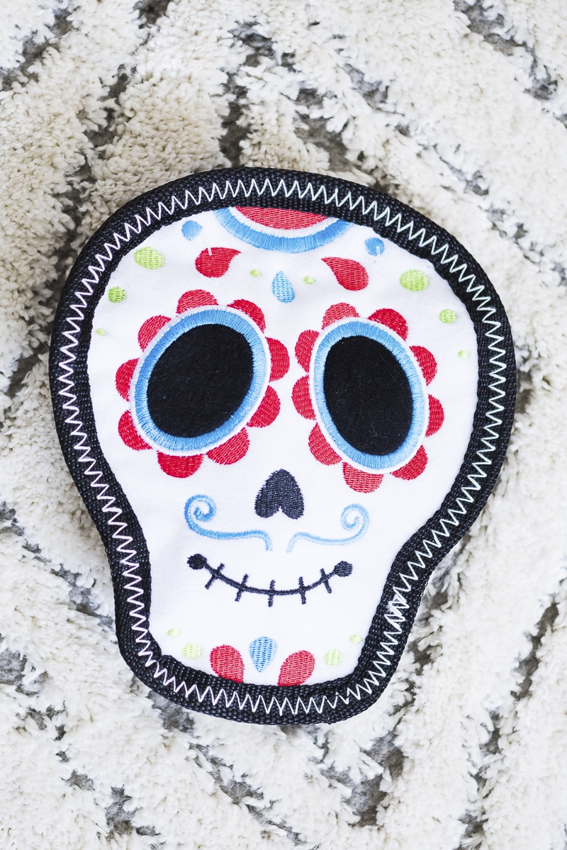 ZippyPaws Fiesta Storybook Sugar skull dog toy for aggressive chewers