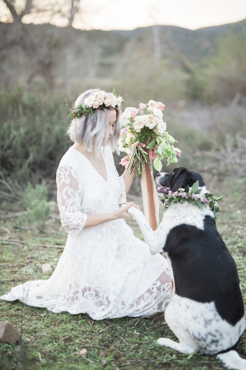 woman wearing white dress and floral crown shaking dog's paw | ©My Sun And Stars | San Diego dreamy styled shoot with dogs and flowers