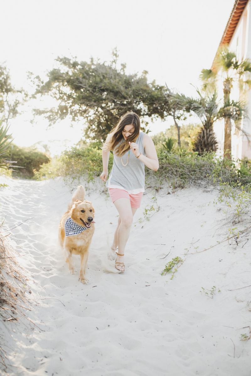 woman running with her dog on sandy beach, ©Rainey Gregg Photography | Golden Isles, GA