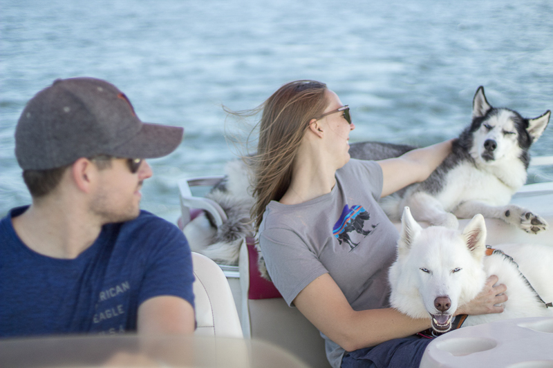 couple and their dogs on a boat, ©Salute Life Photography, Fort Drum, NY, lifestyle dog photography