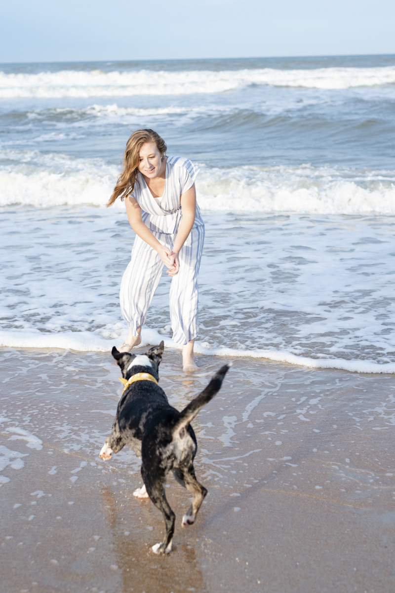 woman and her dog playing at the beach, ©1416 Photography, Marineland Beach Florida,