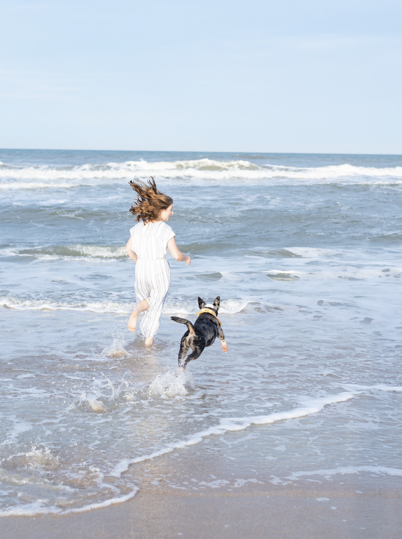 life is better with a dog, woman and dog playing in ocean, ©1416 Photography, Marineland Beach Florida