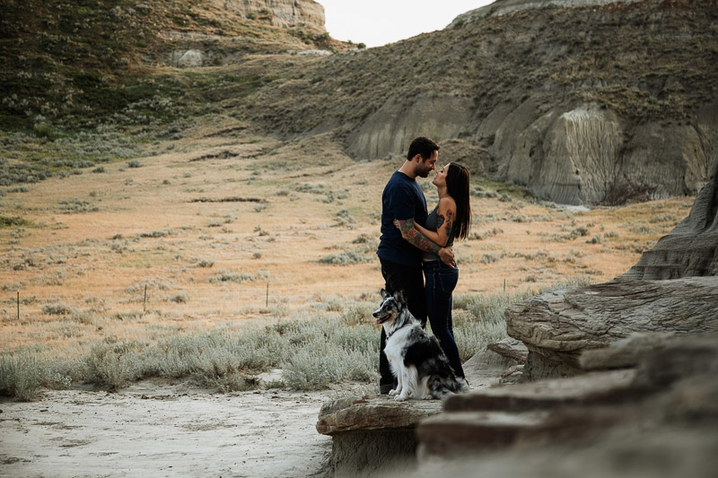 couple and their dog in scenic landscape, ©Jackie Hall Photography