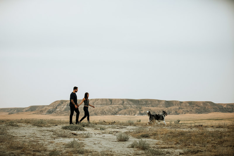 couple walking with their dog in Big Muddy Valley, ©Jackie Hall Photography