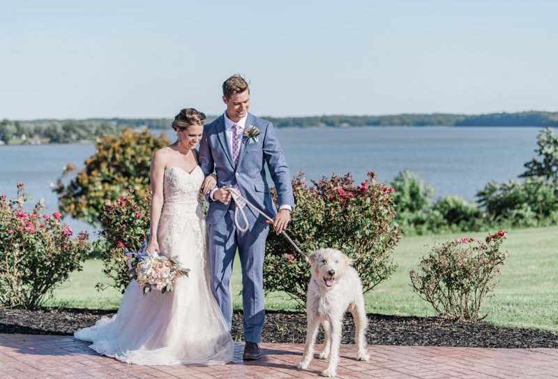 couple and dog with roses, river in background, ©Landrum Photography | dog-friendly wedding