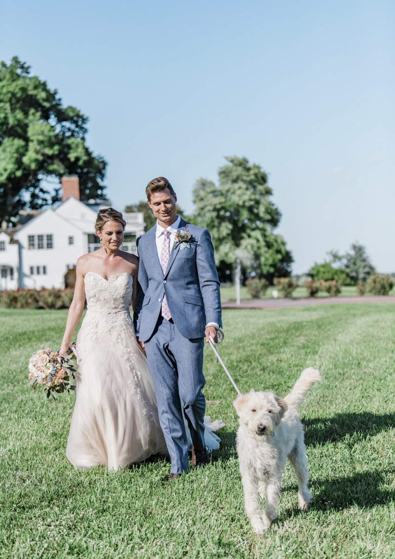 bride, groom and dog walking on grass, Patriotic Styled Shoot | ©Landrum Photography