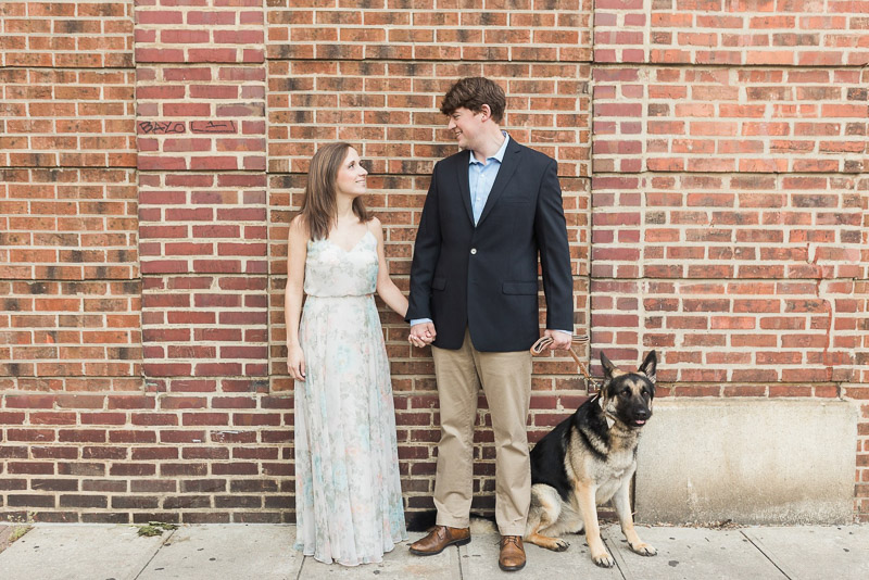 couple wearing dressy outfit with their dog, engagement photos with dog, ©Story & Rhythm, Raleigh, NC engagement session