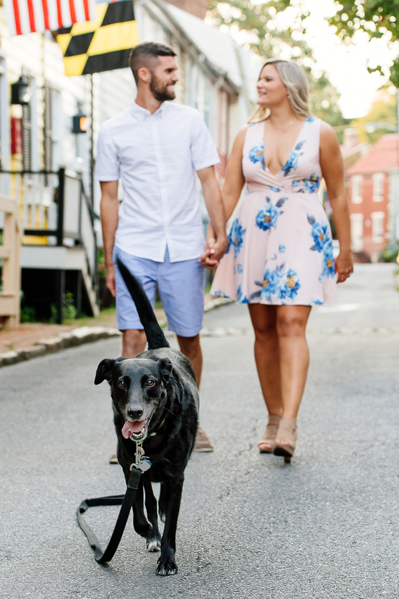 couple walking their dog while holding hands, ©Rachel Smith Photography