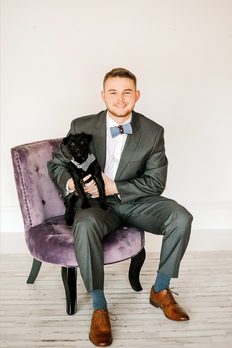 man wearing suit holding dog in bow tie, formal studio portraits with pets ©Samantha Coleman Photography | studio dog photography